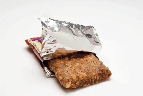 Muesli bar in opened packaging